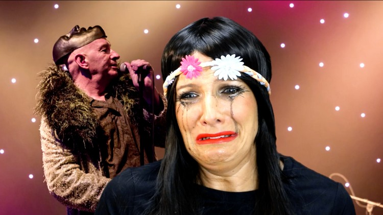 A woman wearing a floral headband cries in front of a greenscreened image of Brian Pern performing. Her make up is smeared from the tears.