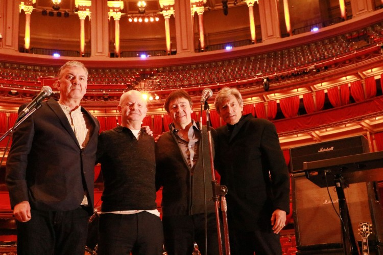 Four men on stage at the Royal Albert Hall.