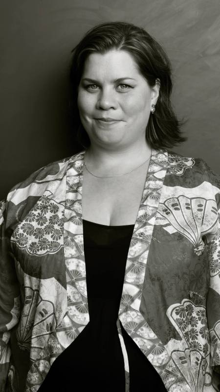 Black and white portrait photo of Katy Brand.