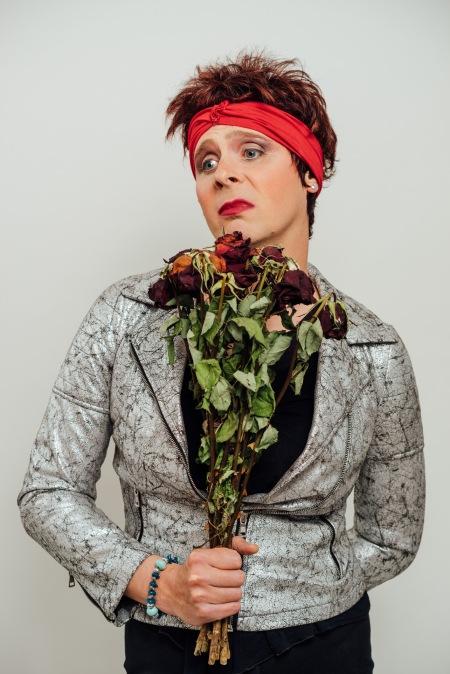 Anna Mann holding dead flowers.
