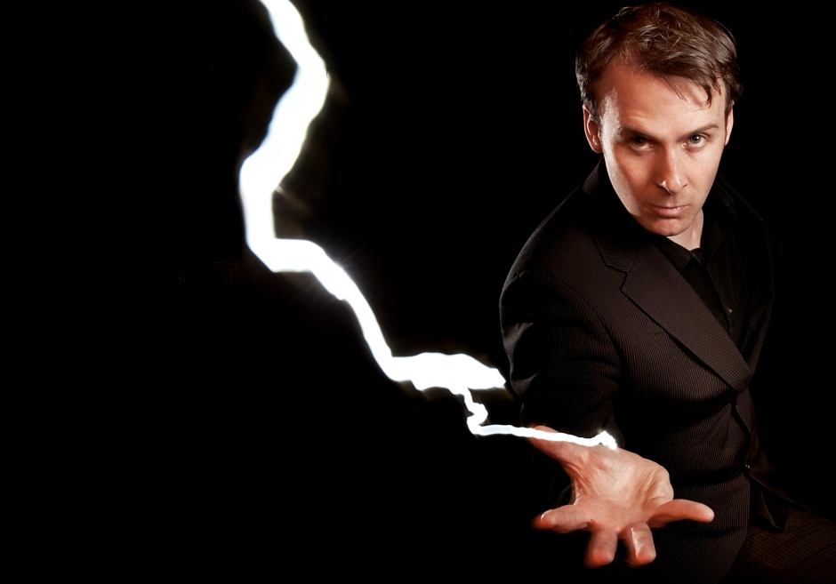 Colin Hoult poses as a bolt of lightning emerges from his wrist.